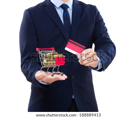 Businessman holding credit card and shopping cart with coin
