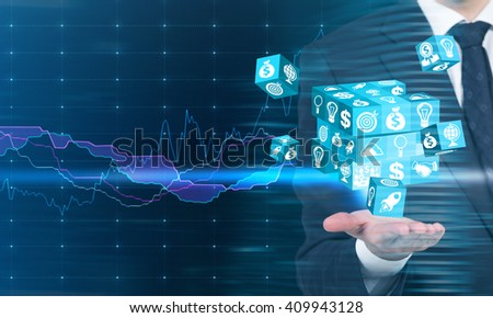 Businessman holding digital cube puzzle in palm with business chart in the background - stock photo
