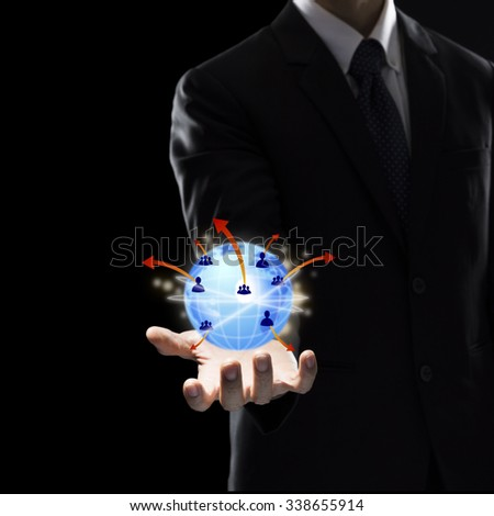 Businessman Holding Digital Globe. Technology Concept - stock photo