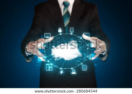 Businessman holding digital icons, Cloud computing concept - stock photo