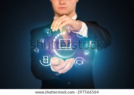 Businessman holding digital media icons