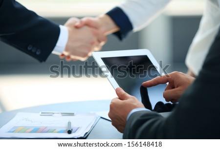 Businessman holding digital tablet - stock photo