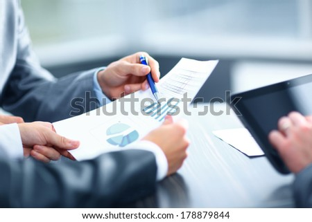 Businessman holding digital tablet at meeting - stock photo