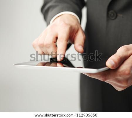 businessman holding digital tablet, closeup - stock photo