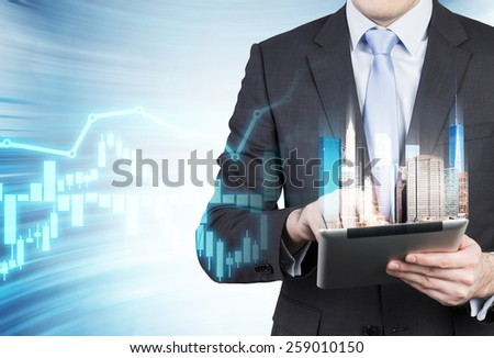 businessman holding digital tablet with modern city - stock photo