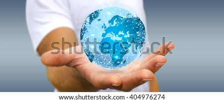 Businessman holding digital web earth with connection lines