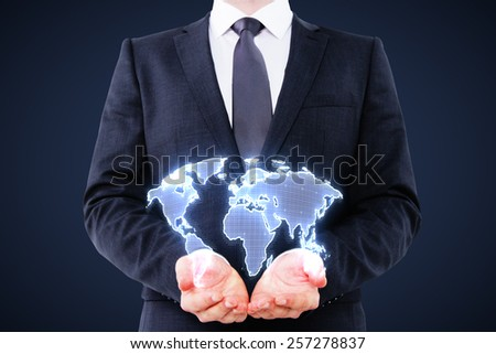 businessman holding digital world map interface on blue background