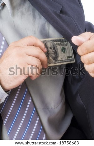 Businessman holding dollar near the pocket .