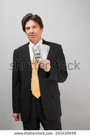 businessman holding dollars - stock photo