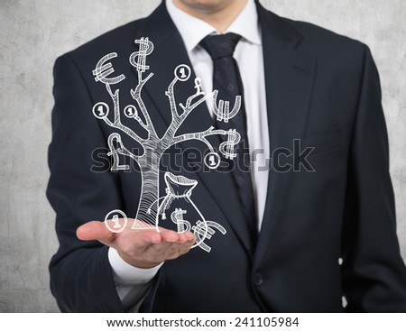 businessman holding drawing money tree - stock photo