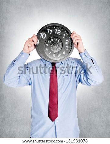 Businessman holding droste effect watch - stock photo