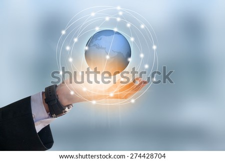 Businessman holding earth