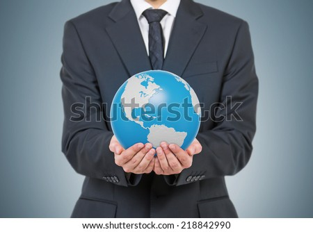 Businessman holding Earth globe, 3D rendering. Americas North and south view.  Elements of this image furnished by NASA