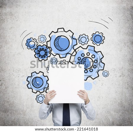 Businessman holding empty banner. A concept of well organized work process - Gears sketch on the wall.  - stock photo