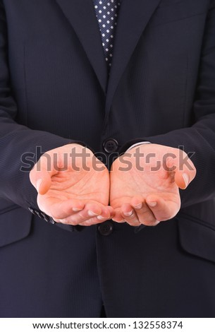Businessman holding empty hands. - stock photo