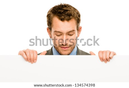 businessman holding empty white placard showing copy space - stock photo