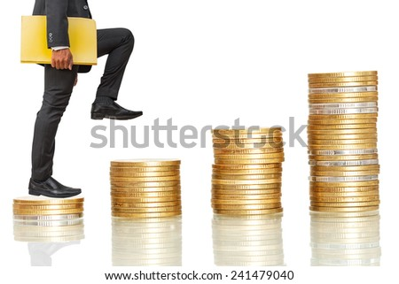 businessman holding files climbing on coins stack to success on white background - stock photo