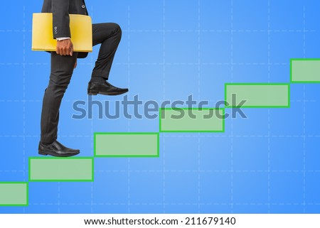businessman holding files climbing on empty green boxes to success - stock photo