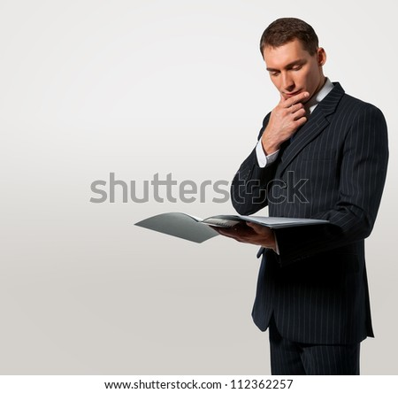 Businessman holding folder with documents