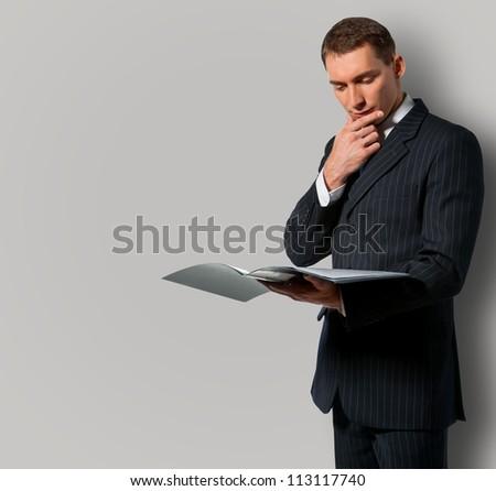 Businessman holding folder with documents - stock photo