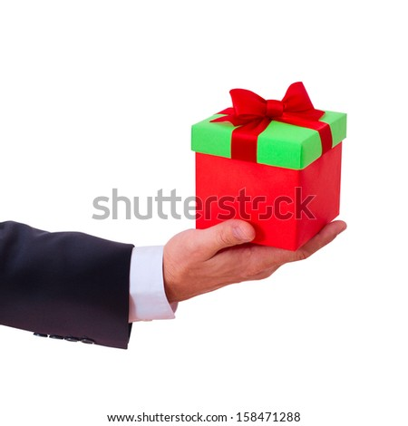 businessman holding  gift box with red bow