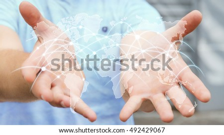 Businessman holding global network and data exchanges over the world 3D rendering??