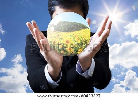Businessman holding globe in hand