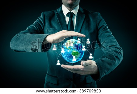 Businessman holding globe in his hands. The concept of personnel management around the world - stock photo