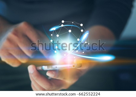 Businessman holding glowing globe.