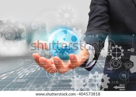 Businessman holding glowing globe,futuristic technology background - stock photo