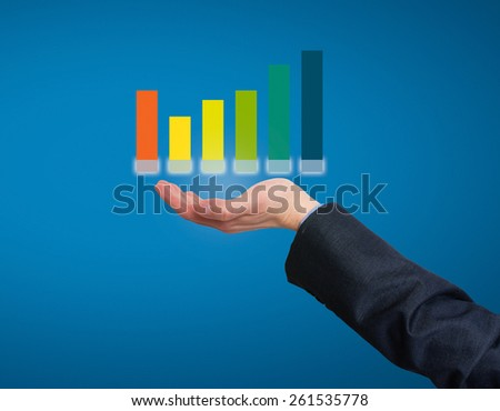 Businessman holding graph in his hand . Office - Stock Photo