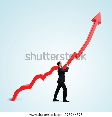 businessman holding graph on a blue background - stock photo
