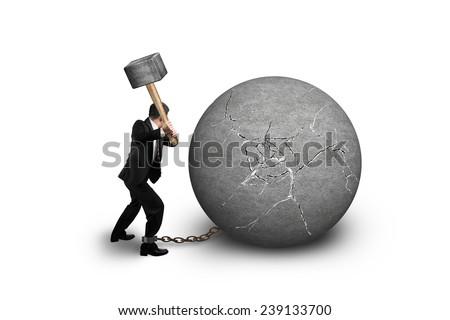 businessman holding hammer hitting cracked concrete ball isolated on white background - stock photo