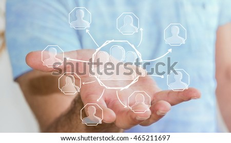 Businessman holding hand drawn social network interface