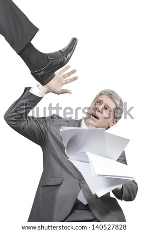 Businessman holding hand high to show something on a isolated white wall/Businessman gesturing - stock photo