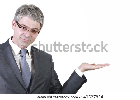 Businessman holding hand high to show something on a isolated white wall/Businessman gesturing