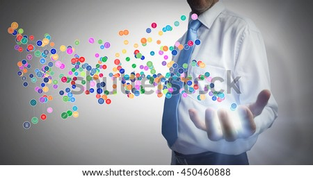 Businessman holding hand out against grey background