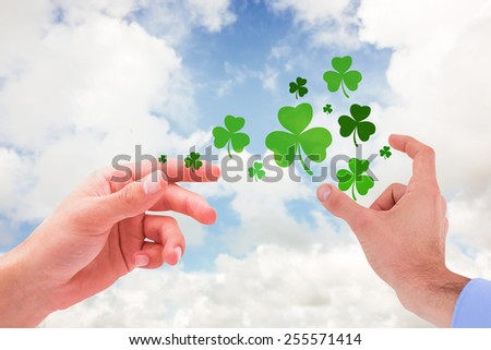 Businessman holding hand out in presentation against blue sky with white clouds - stock photo
