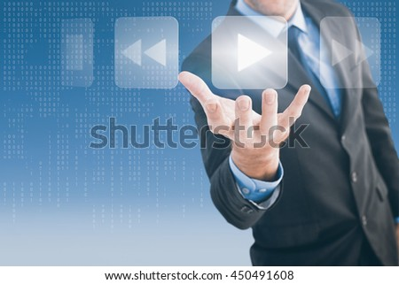 Businessman holding hand out in presentation against computer screen with binary numbers