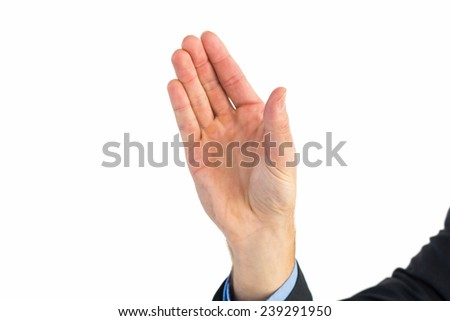 Businessman holding hand out in presentation on white background