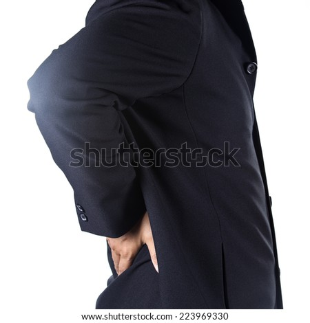 Businessman holding hands on his aching back on white background - stock photo