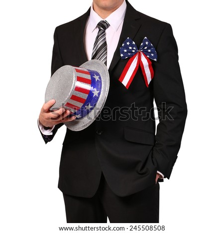 Businessman holding Hat with American Flag isolated on white - stock photo