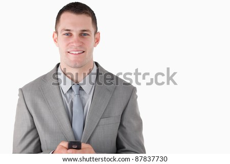 Businessman holding his cellphone against a white background