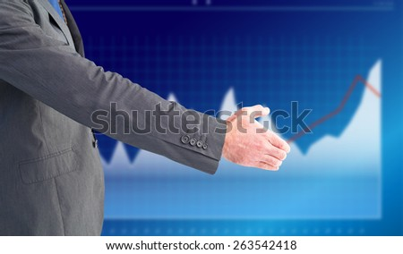 Businessman holding his hand out against business interface with graphs and data - stock photo