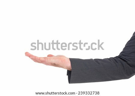 Businessman holding his hand out on white background
