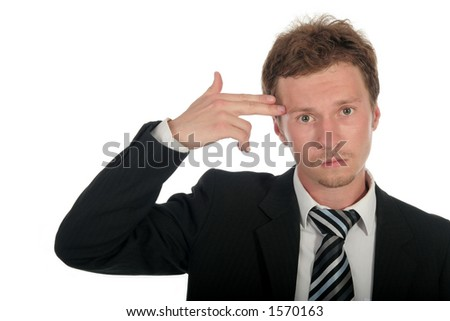 Businessman holding his hand to his head, mimicking a gun