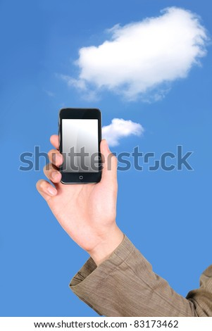 Businessman holding his mobile phone on cloud