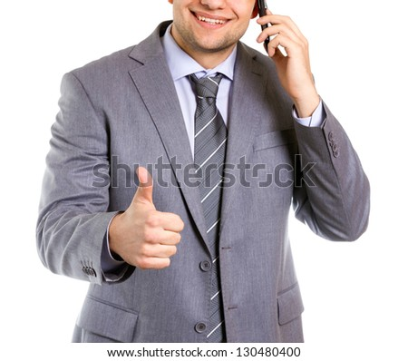 Businessman holding his thumb up for success