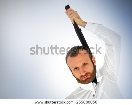 Businessman holding his tie: failure and job related problems conceptual photo. - stock photo