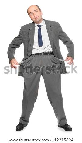 Businessman holding his two empty pockets. Crisis metaphor. - stock photo